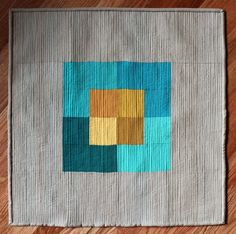 """Beautifully textured """"Colour Study in Teal and Gold"""" by Debbie Jeske of A Quilter's Table."""