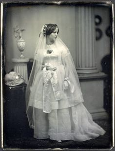 1850 daguerrotype of bride wearing a relatively simple but elegant wedding gown.