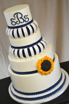 Arched Navy Blue And Sunflowers Italian Buttercream cake with gumpaste arches and navy blue fondant accents. Blue Wedding Colour Theme, Navy Blue Wedding Cakes, Round Wedding Cakes, Yellow Weddings, Italian Buttercream, Buttercream Cake, Cake Fondant, Beautiful Cakes, Amazing Cakes