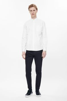 A neat slim fit, these tailored trousers are made from a cotton-mix with a stretch finish. A tapered style, they have front and back pockets, a zip fly fastening and belt loops.