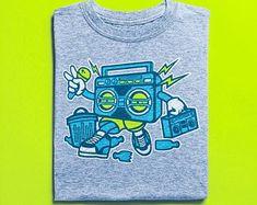 View Surf Shirts by BuyVintageShirts on Etsy Surf Shirt, T Shirt, Skater Shirts, Boombox, Vintage Shirts, Tshirts Online, Graffiti, Street Art, Mens Tops
