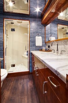 Hatteras GT Everything in this head is motoryacht quality and execution. Note the frameless glass shower door and the marble counter with backsplash. There is a mirror on the overhead for extra light and to make the space feel larger. Yacht Interior, Interior Design, Hatteras Yachts, Sport Fishing, Shower Doors, Double Vanity, Convertible, House Plans, Mirror