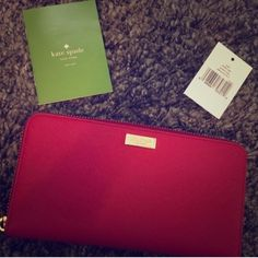 Stunning Kate Spade Newbury Lane Wallet Beautiful Kate Spade Newbury Lane Zip-Around Wallet in Pillbox Red. Gold plated hardware. 12 Credit card sleeves. Zip coin purse. Deep sleeves for cash. Zip closure. Kate Spade Tags included. Gold plated front hardware shows tiny minor scratches. Flawless elsewhere. Stop by my closet for more great items to bundle! *Please submit respectable offers using the private offer feature and keep all comments classy.* Sorry...Trades. kate spade Bags Wallets