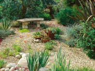 Small pea sized gravel is used for soft pathways in a garden. Soft surfacing for garden pathways consists of natural materials that include combinations of stone, wood and shell.