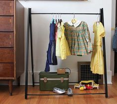 Buy or DIY: Dress Up Clothes Storage...I've been thinking about a combo of a vintage suitcase and a rack!