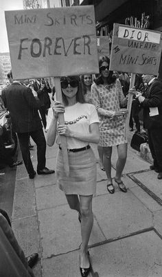 "Pro-mini skirt sirls protesting against ""Dior style"" clothing on the street of London in 1960s. They look very modern, their outfits fit in with any closet nowadays."
