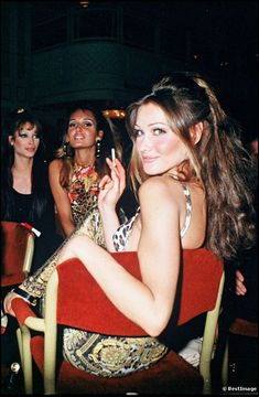 Carla Bruni with Gail Elliot and Christy Turlington in the background