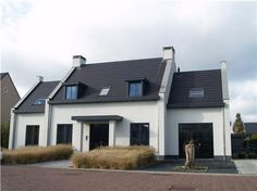 Dark Slate Roof White Modern House With Accent