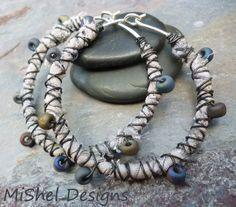 Rustic Boho Wire Wrapped Sari Silk and Beaded Hoop Earrings. $32.00, via Etsy.