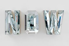 Faceted mirrored letters by Doug Aitken featured on the cover of Elle Decor.
