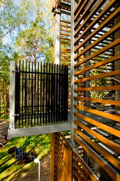 this 38-meter tall structure is clad with a delicate open-air cage and cantilevered balconies at varied elevations to allow continuous views of the encompassing nature reserve.