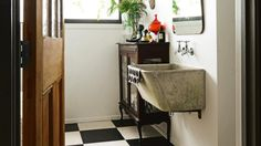 The new bathroom features a laundry tub that was found on the property; the…