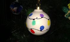 Every year my kids give family and friends some type of handmade Christmas ornament. This year I started out by buying plain white Christmas balls at A.C. Moore.  I used a black Sharpie to draw on the cord and then the kids dipped their pinkies in different colored acrylic paints to make the bulbs.  Spraying it with a clear sealer will keep the paint from chipping and scratching off!