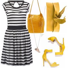 Vestito di maglina a righe bianche e nere, accompagnati da accessori di colore giallo per dare un pizzico di vivacità. Sandali col tacco sottile, cintura e borsa a secchiello. Collana richiama angeli, unico accessorio prezioso.