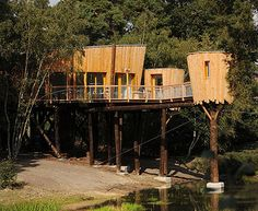 """Just south of Eindhoven, perched 20 feet above a river bank in The Netherland's Heeze-Leende, sits ""Kaban,"" architect Renaud Morel's fantastical tree house""...http://inhabitat.com/renaud-morels-kaban-tree-house-for-adults/"