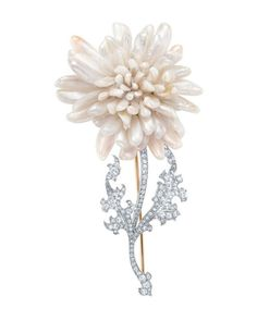 Chief Tiffany Designer Paulding Farnham (1859-1927), a master of botanic illustration, created a collection of floral jewels that won more honors than that of any other jewelry designer of his time. This brooch of freshwater pearls (c.1904) is patterned after a chrysanthemum, with a stem and leaves of diamonds set in gold-backed platinum. The flower, found in China and Japan, became a popular jewelry motif after Japan opened to Western trade.