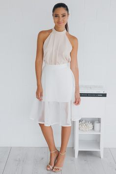 colour: ivoryfabric: polyester, spandexfit: standard sizing, relaxed skirt, light weight fabric, sheer mesh fabric overlay, exposed silver zipper, the fit differs on waist depending on sizelength: 41cm from waist to hem of lining, 63cm from waist to sheer hemour model is 163cm tall and is picture...