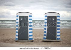 Modern public toilets on the beach; two cabins - stock photo