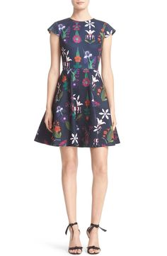 In love with this classic skater dress that is updated with a vibrant floral print and a full-circle cut skirt.