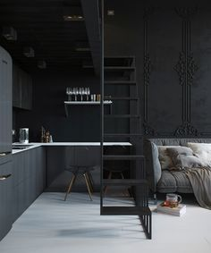 Dark charcoal grey kitchen with a white work top. Small but perfect kitchen tucked into the corner of this living space.