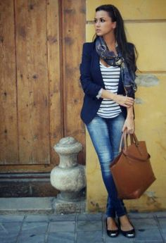 Stripes blouse with dark blue coat and blue casual jeans and brown leather hand bag and black pumps