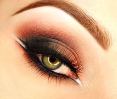 Warm and smokey this look by kamilcia using the Makeup Geek eye shadows Bitten, Corrupt, and Mango Tango is perfect for a night out.