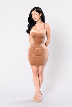 - Available in Brown and Magenta - Velvet Dress - Sleeveless - Adjustable Spaghetti Straps - Mini Dress - 90% Polyester 10% Spandex