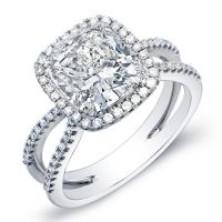 Mesmerize her with this beautiful 1.96 Ct. diamond engagement ring. The center stone is an EGL certified 1.01 Ct. Cushion cut diamond with J color grade and VS2 clarity. A halo of 0.95 Ct. pave set Round cut diamonds accent the center stone and flow down the split shank with matching I-J color grade and VS1-VS2 clarity. This diamond ring is available in 14K white or yellow gold, 18K white or yellow gold or platinum.