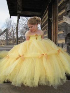 Belle makes the perfect princess, she is so loving and giving. We created our version of her dress with this beautiful high quality yellow tulle and gold satin ribbon. The straps are a glittered organza to add to that royal look.This costume is perfect for a princess party or Halloween. We make our skirts very full with 6 layers of tulle for that perfect fullness of a princess. I can make most any size. Also avaliable in other princesses. Convo for more info.