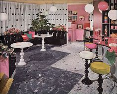 There are some great elements here. The freeform 'bar' for one. The black vinyl banquette for another. I'm also rather fond of the black and white polka-dot curtains. Like the idea of pink as the accent color in a mostly black and white finished basement. No to those table and stool bases though. 1953 Armstrong Party Room