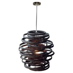 Rattan pendant with a spiral design. Hand-woven in Indonesia.  Product: PendantConstruction Material: Rattan