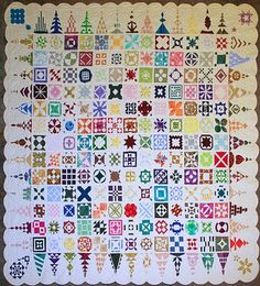"""My Dear Jane (aka """"Insanity""""), by Karen Goad, at Karen's Quilting    Karen Goad hand-pieced and hand-quilted this beautiful heirloom, which is made of 4,928 pieces of fabric. No two blocks have the same fabric! All the blocks are made from scraps, in all colors of the rainbow, giving the quilt a gem-like quality. Karen Goad estimates that the quilt took 645 hours and 30 minutes of work."""