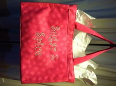 """Personalized gift bag available in 7 prints, 7 fonts and 24 thread colors. Bag has mesh pocket on each side and measures 8"""" high, 12"""" wide, 6.5"""" deep.  Perfect for baby, birthday, wedding party, grad gifts.  Shown here in Pink Lotsa Dots print, style 12 font in platinum thread.  Item #3258."""