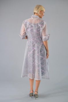 The beautiful design of this classic collared pure silk organza coat makes it a wonderful addition to any wardrobe. Ideal over many Living Silk dresses, it also looks fantastic over pants and cami. The Jasmine Lace motif is embroidered at the front on the hemline and adds wonderful detail to this garment.  Shown here in Silver. Available in a range of colours. Sizing corresponds to Australian standard sizing as follows: XS:   6-8S:    8-10M:   10-12L:    12-14XL:  …