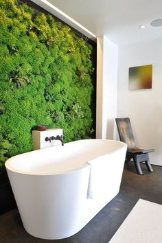 "A living wall in a master bathroom — which Kevin Hackett and Jessica Weigley designed as a ""healing wall"" — holds a lush assortment of herbs, geraniums and mosses. A watering system trickles down the wall to keep the fragrant bursts of mint and lavender fresh."
