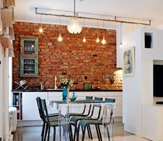 for my apartment someday... brick wall... light bulbs almost like track lights... the clear table... <3