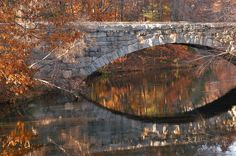 Stone Arch Bridge across Blackstone Canal in Blackstone River and Canal Heritage State Park. Uxbridge, Massachusetts
