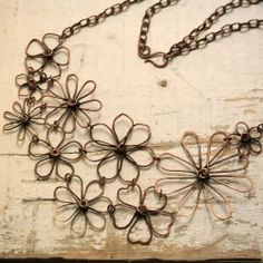 Corabella - copper flower pendant.  see instructions for flower ring with stone in center and link tog. like this necklace