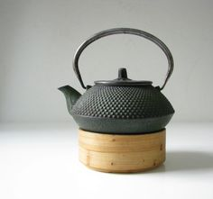 Cast Iron Hobnail Teapot with Bamboo Stand by BeeJayKay on Etsy, $45.00