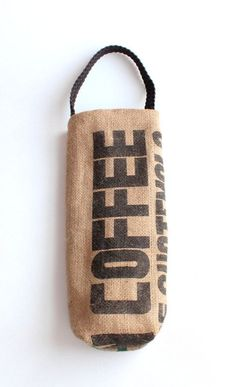 Coffee Sack Wine Tote Carry your favorite bottle of wine in this one-of-a-kind, upcycled coffee sack wine tote. This bag is created from castoffs. From a coffee bean roaster on Cleveland's west side, (Bottle Design Flour Sacks) Burlap Coffee Bags, Burlap Tote, Burlap Sacks, Coffee Bean Sacks, Coffee Beans, Burlap Crafts, Wine Tote, Jute Bags, Coffee Roasting