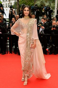 All The Best From The Cannes Red Carpets #refinery29 http://www.refinery29.com/2014/05/68261/best-dressed-cannes-2014#slide19 Sonam Kapoor mixes metallic-embroidery glitz with ethereal (and sheer!) pastels in her Anamika Khanna sari.