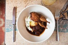 Chef Nick Mueller's pan-fried quail, red eye gravy, smoked sausage and mashed potatoes. Photographed by Angela Hopper