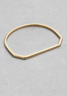& OTHER STORIES This shiny square-wire bangle has an angular design that lends it an city-chic edge.