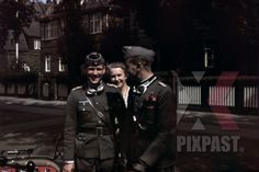 Two Wehrmacht soldiers say farewell to their mother in Hamburg, Germany ~1941