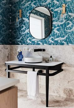 **Powder room** Centred on the spectacular wallpaper, the oval Flynn mirror from Warranbrooke pairs with an Issy Z1 Ballerina vanity unit by [Zuster] for [Reece Bathroom Life].