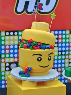 Lego Cakes. Don't show my grandsons. I love the last wedding cake. and can do without pink legos. Let us no discuss the amount of Legos in this house. And I don't have any little kids.