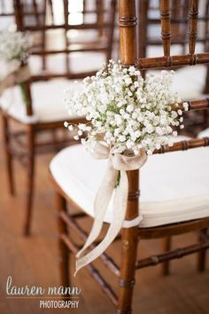 Light and airy blooms ties with burlap ribbon for wedding ceremony (photo courtesy of Lauren Mann Photography)