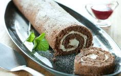 Chocolate Yule Log...Fun to make, a delight to the eyes and absolutely yummy, this jelly roll-style cake is a holiday favorite.