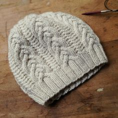 Perfect cable hat. Ravelry pattern here: http://www.ravelry.com/projects/karentempler/gentian