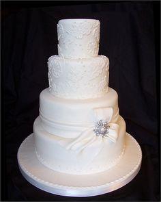 White Lace wedding cake with aqua ribbon.